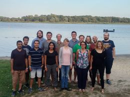 Picture of a group of young researchers in front of a lake during the Jamboree 2018 in Bollmannsruh